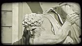viyana : tilting shot of a statue of two men in Vienna. Vintage stylized video clip.