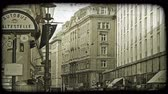 árnyék : Shot of buildings in Vienna as the sun is hidden behind a cloud. Vintage stylized video clip.
