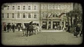 viyana : Tilt down and pan left shot of a Vienna courtyard from buildings to a carriage. Vintage stylized video clip.