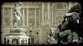 europa : pan left shot of two statues in front of a building in Vienna. Vintage stylized video clip.
