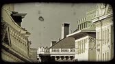 europa : A shot of the rooftops of several Vienna buildings. Vintage stylized video clip.