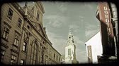 viyana : Shot of a church steeple behind a building in Vienna. Vintage stylized video clip.