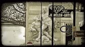 viyana : Shot of a statue on a building behind a jewelry store sign in Vienna. Vintage stylized video clip.