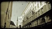viyana : View of buildings in Vienna with a church steeple in the background. Vintage stylized video clip.