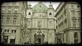 bisiklete binme : Shot of a building in Vienna as people and cars pass. Vintage stylized video clip.
