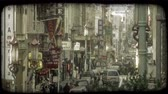 personagem : Busy, car-lined street in Chinatown of San Fransisco in California with tall banners waving, oriental stoplights lining street, and people walking along sidewalks. Vintage stylized video clip.