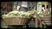 вещь : A shot of bananas and other fruit in baskets at an Italian fruit stand. Vintage stylized video clip. Стоковые видеозаписи