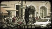 idegen : Wideshot of foreign policeman waving traffic. Vintage stylized video clip.