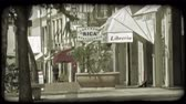sklep : Shot of an Italian sidewalk lined with shops. Vintage stylized video clip.