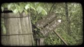 beczka : Shot of a direction sign leaning against a barrel in Italy. Vintage stylized video clip.