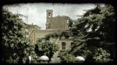 tető : Shot of a Bell tower behind several buildings in Italy. Vintage stylized video clip.