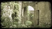 escuro : Shot of an archway connecting two buildings in Italy. Vintage stylized video clip. Stock Footage