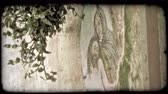 italiano : A lock sown shot of a mural of Christ. Vintage stylized video clip.
