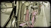 античный : A lock down shot of a pink Italian bicycle. Vintage stylized video clip. Стоковые видеозаписи
