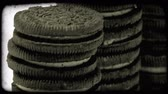 caloria : Tilting shot of sandwich cookies. Vintage stylized video clip.