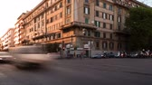 corner : Time-lapse of busy traffic on a street corner in Rome, Italy. Panning shot.