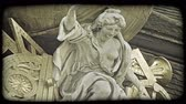 viyana : Shot of a statue atop a building in Vienna. Vintage stylized video clip.