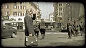 corner : Three Monks walking through the city streets. Vintage stylized video clip.