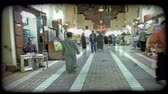 купить : A walking shot of people passing through a Kuwaiti marketplace. Vintage stylized video clip.