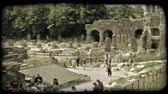 pilíř : People sit around and walk through ruins. Vintage stylized video clip. Dostupné videozáznamy