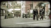 idegen : A zoom out of two Italian police officers walking down the street. Vintage stylized video clip. Stock mozgókép