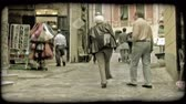 europa : People walk and shop on an Italian street. Vintage stylized video clip. Stock Footage