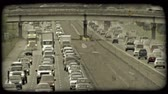 fordulat : Time lapse of congested traffic along city highways, opposite directions running parallel to each other with highway overpass above both highways. Vintage stylized video clip.