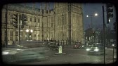 político : Time-lapse of English double decker buses, cars, and people crossing the lit street adjoining the English Parliament in London, England at dusk. Vintage stylized video clip.