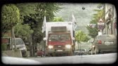 вещь : Shot of a red cabin truck driving on a road in Italy. Vintage stylized video clip. Стоковые видеозаписи