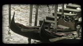 вещь : A shot of a gondola tied to a dock in a Venice canal. Vintage stylized video clip.