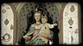 bakire : A lock down sot of a statue of the Virgin Mary holding the young Jesus Christ in an Italian cathedral. Vintage stylized video clip. Stok Video