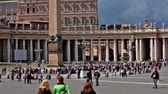 база : Groups of tourists sightseeing around St Peters Square in Vatican City on a sunny day in 2012. The obelisk and one fountain are visible. Стоковые видеозаписи
