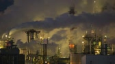 dumanlı : Stationary shot of factory smoke stacks during the night in Wyoming.