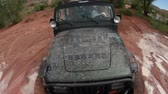 lamacento : High angle probe view of a jeep driving through a dirty landscape in Moab Utah. Stock Footage