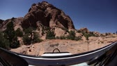 wydmy : Traveling shot of a Jeep through the desert Moab, Utah.