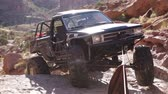 lamacento : Stationary shot of Jeep pulled up the last bit of a slope by cables in Moab, UT