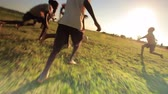 Shot of children playing soccer on the fields in Kenya, Africa.