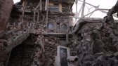 peculiar : Move up the rough, rocky walls of the building at Thunder Mountain Park in Imlay, Nevada. Stock Footage