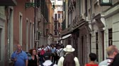 тент : Slow motion shot of people walking down a narrow street,flanked on both sides by tall,old buildings. Shot with a high speed camera on May 2,2012 in Venice,Italy