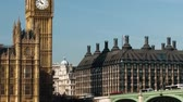 politics : Time-lapse of Westminster Bridge in London. Traffic can be seen on the bridge and the Thames as Big Ben stands in the background. Filmed in October 2011. Panning shot. Stock Footage
