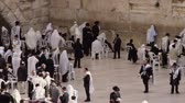 judaico : Wide shot of male Jews praying at the Western Wall Wailing Wall at a portion of what is left of Solomons Temple in Jerusalem, Israel. Shot with the Red One digital camera at 4k 4096 x 2304 resolution. 02262011
