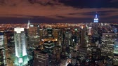 известный : New York cityscape time-lapse from the Rockefeller building. The Chrysler and Empire State Buildings are visible. Shot in New York City USA.
