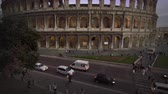 corner : Footage of vehicles on the street next to the northwest corner of the Colosseums exterior,including the arch of Constantine. Filmed in Rome,Italy on May 6,2012