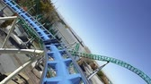 parkosított : First person view of a roller coaster riding the peaks and slopes of the track.