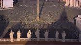 база : Aerial footage of crowds and statues around the obelisk in St. Peters square. Filmed in Rome,Italy on May 8,2012