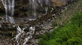 bosques : People on the rocky hillside at the bottom of Bridal Veil Falls in Provo Canyon Utah.