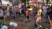 namorado : A shot of a boy winning a prize at a carnival game and handing it to his date