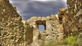 arqueológico : Low-angle time lapse of the roofless stone walls and door of a ruin