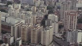 helicóptero : Slow motion aerial footage of urban Rio de Janeiro, Brazil. Filmed from a moving helicopter.