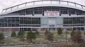 zábava : Golden, Colorado - August, 2013: Slow motion upward pan of the Sports Authority stadium.